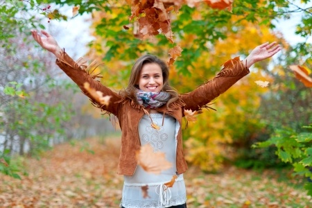 SOHP.com-Happy-Girl-in-Fall-Leaves